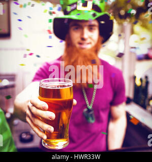 Flying colours against disguised man holding pint 3d - Stock Photo
