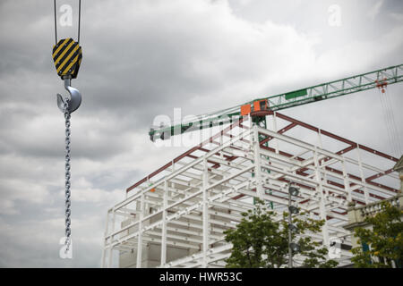 Studio Shoot of a crane lifting hook against crane at construction site - Stock Photo