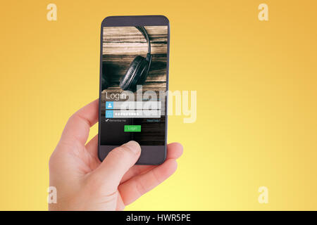 Female hand holding a smartphone against smartphone screen with headset - Stock Photo