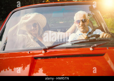 Image of a Couple doing a car trip - Stock Photo