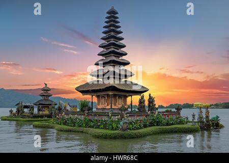Ulun Danu temple Beratan Lake in Bali Indonesia at sunset - Stock Photo