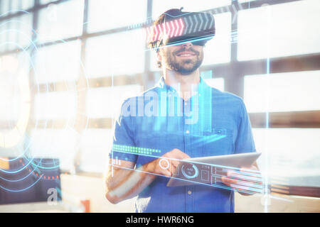 Digitally generated image of volume knob with graphical data against male business executive in virtual reality - Stock Photo