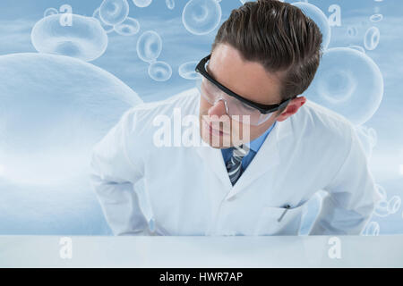 Doctor wearing protective eyewear against red blood cells in human body 3d - Stock Photo