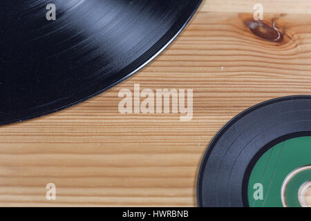 Vinyl Record And Compact Disc On Wood - Stock Photo
