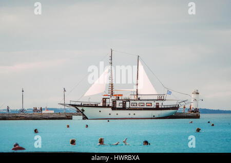 PEFKOHORI, GREECE - MAY 26, 2015: Sailing ship moored in marina of Pefkohori, Halkidiki, Greece, Aegean sea. After - Stock Photo