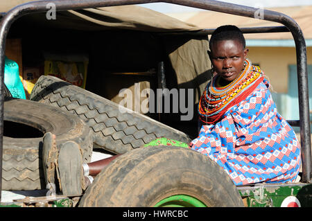 MARARAL, KENYA - JULY 03: African woman from the Samburu tribe with characteristic decorative necklaces is waiting - Stock Photo