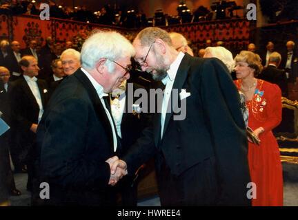 THORGNY LINDGREN Swedish author and member of Swedish academy congratulate the Irish laureate Seamus Heaney to the - Stock Photo