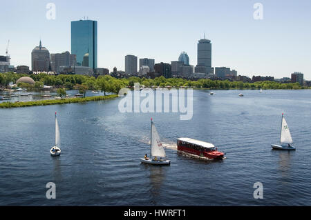 The Back Bay skyline and the Charles River from the Longfellow Bridge -   Community Boating Sailboats and a Duck Tour boat are in the foreground,