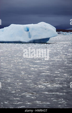 A big white iceberg floating in Jokulsarlon (Jökulsárlón) -  large glacial lake in Iceland on the edge of Vatnajökull - Stock Photo