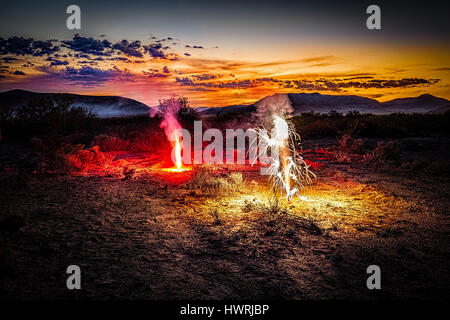 A fireworks display on the Fourth of July in the desert near El Paso, TX. - Stock Photo