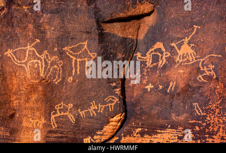 Anicent Camel Petroglyphs Wadi Rum Valley of the Moon Jordan.  Inhabited by humans since prehistoric times, place - Stock Photo