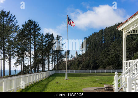The grassy lawn of Heceta Head Light Station Bed and Breakfast has an excellent view beyond the white picket fence - Stock Photo