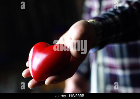 male hand valentine heart gift - Stock Photo