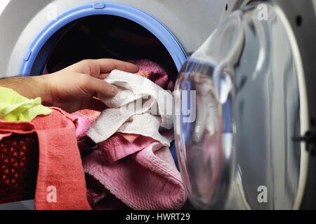 machine Washer hand put - Stock Photo