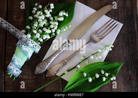 vintage cutlery and bouquet - Stock Photo