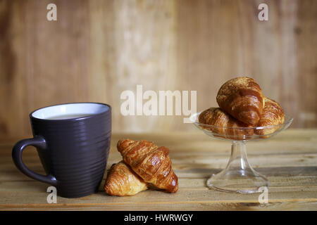 cup croissant breakfast wooden background - Stock Photo