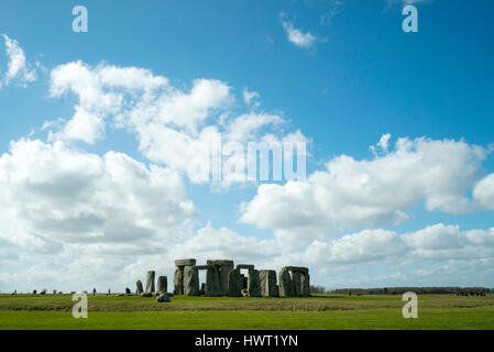 Mid distance view of Stonehenge on field against cloudy sky - Stock Photo