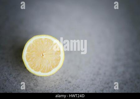 Close-up of lemon slice on table - Stock Photo
