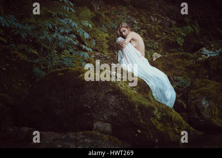 Beautiful maiden in Mother nature sanctuary. Romantic and dreamy - Stock Photo