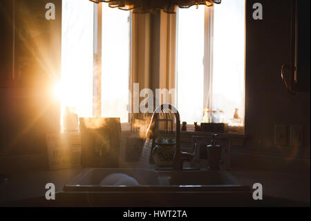 Sunlight emitting through window in kitchen at home - Stock Photo