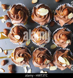 High angle view of cupcakes arranged on table - Stock Photo