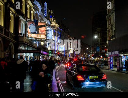 Theatres in Shaftesbury Avenue London busy street scene night - Stock Photo