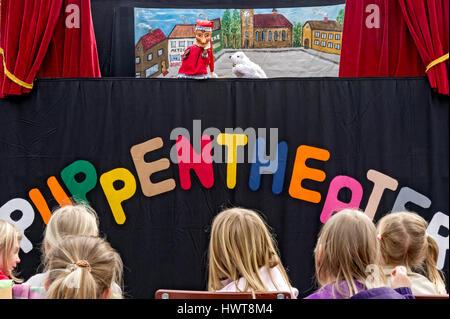 Children watching the puppet theater, Upper Bavaria, Bavaria, Germany - Stock Photo