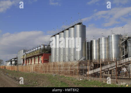 Modern Wine production and metalic Wine storage tanks at a winery - Stock Photo