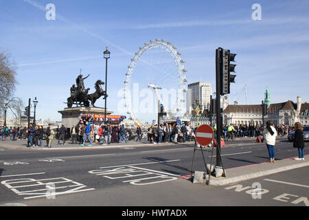 Tourists sightseeing on Westminster Bridge London - Stock Photo
