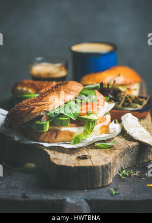 Close-up of bagel with salmon, cream cheese and vebegables - Stock Photo