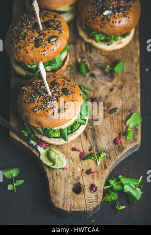 Healthy homemade vegan burger with beetroot-quinoa patty, copy space - Stock Photo