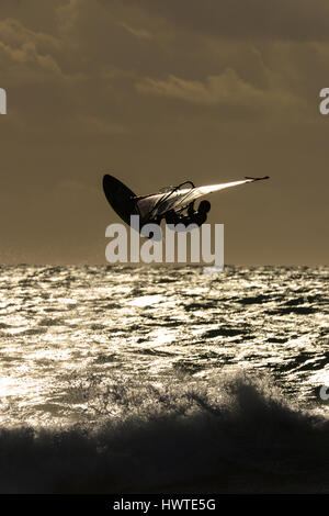Windsurfer in the evening sun in the camargue - Stock Photo