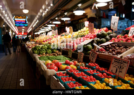 SEATTLE, WASHINGTON, USA - JAN 24th, 2017: Vegetables for sale in the high stalls at the Pike Place Market. This - Stock Photo