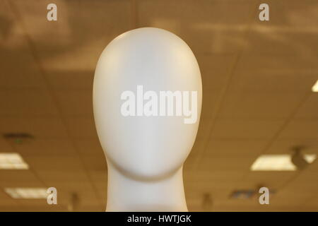 White plastic mannequin. Faceless person or dummy. Faceless mannequin with no clothes on the demonstration. A face - Stock Photo