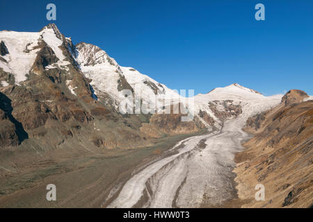 The Großglockner peak and Pasterze Glacier in the Hohe Tauern National Park in Austria on a clear day. - Stock Photo