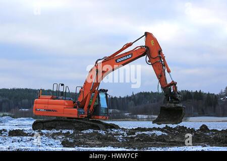 SALO, FINLAND - NOVEMBER 27, 2016: Doosan DX255LC Medium Crawler Excavator at work in the road construction project - Stock Photo