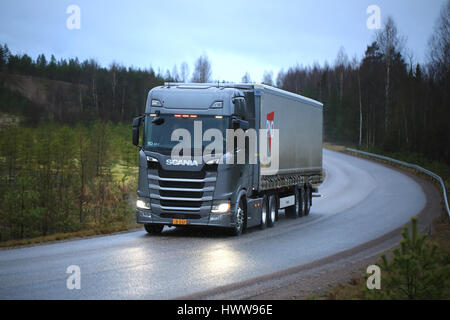 LOHJA, FINLAND - NOVEMBER 24, 2016: New Next Generation Scania R truck on the road in November sleet and rain. Scania - Stock Photo