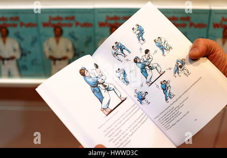 The opened book 'Judo with Vladimir Putin' can be seen at the book fair in Leipzig, Germany, 23 March 2017. With - Stock Photo