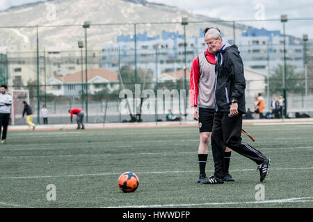 Gibraltar – 23rd March 2017 –Anthony Hernandez from Gibraltar United prepares to take a free kick as Jeff Wood the - Stock Photo