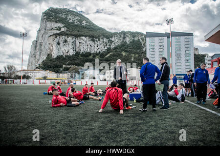 Gibraltar – 23rd March 2017 – The Gibraltar national squad rest after a training session with the Rock of Gibraltar - Stock Photo