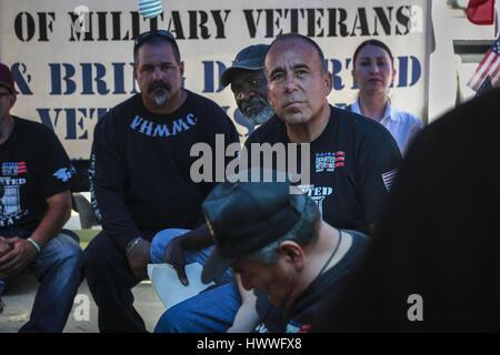 March 18, 2017 - Tijuana, Baja California, Mexico - JAIME OROZCO, center right, a veteran of the U.S. Army, listens - Stock Photo