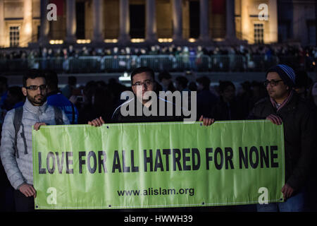 London, UK. 23rd March, 2017. Members of the UK's Muslim population with a banner reading 'Love For All Hatred For None' in Trafalgar Square following the vigil for the victims of yesterday's terror attack on Westminster Bridge and the Palace of Westminster. Credit: Mark Kerrison/Alamy Live News