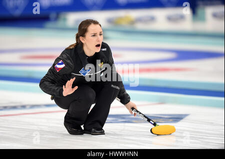 Beijing, China. 23rd Mar, 2017. Anna Sidorova of Russia competes during the World Women's Curling Championship round - Stock Photo