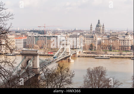 BUDAPEST, HUNGARY - FEBRUARY 20, 2016: View of the Szechenyi Chain Bridge over Danube River and church St. Stephen's - Stock Photo