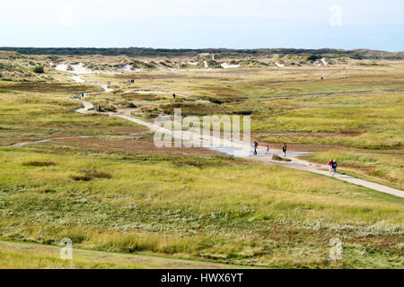 People walking in dune valley the Slufter of national park on West Frisian Waddensea island Texel, North Holland, - Stock Photo