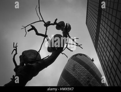 Swiiss re building or 30 st mary axe city of london fine art image with outdoor sculpture - Stock Photo