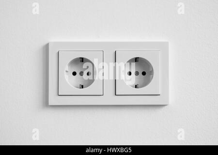 white double socket on wall - electric plug - Stock Photo