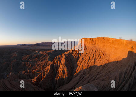 Sunrise lights the rugged cliffs of Font's Point at Anza-Borrego Desert State Park in San Diego, California. - Stock Photo