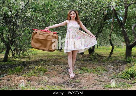 woman outdoor travel suitcase retro - Stock Photo