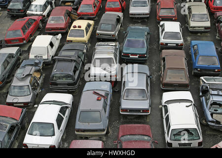 Scrap Car Recycle Yard with lots of old crushed cars - Stock Photo